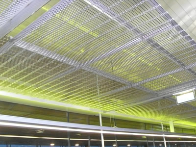 Hanging ceiling is decorated with white woven wire drapery.