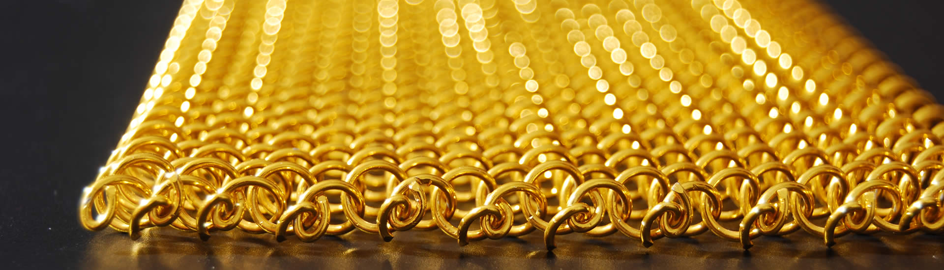 Details about edge of golden metal coil drapery.