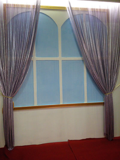 Pink metal cloth curtain as window curtain is fastened.