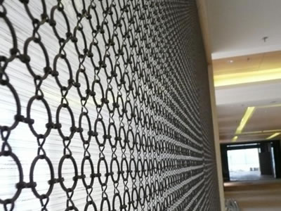 Stainless steel ring mesh curtain with 8 type ferrule as hallway divider.