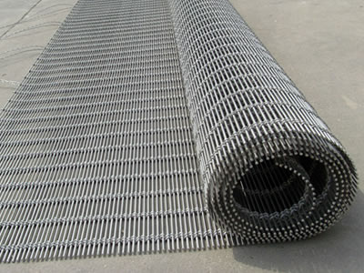 A roll of stainless steel woven wire drapery.