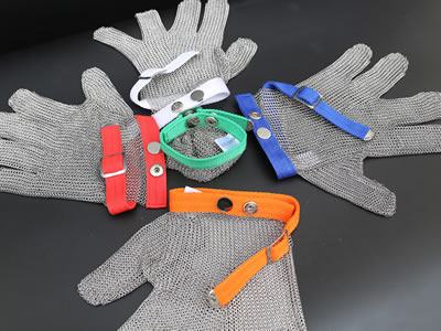 There are five gloves with different wrist strap colors on the black background.