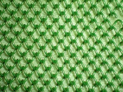 Flexible mesh curtain in green color on the light green background.