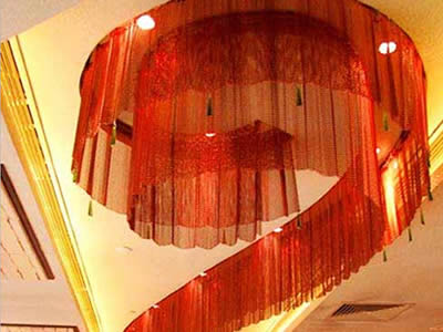 Chinese red flexible mesh curtain is installed in the luxury building as a lamp shade.