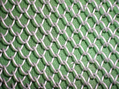 Flexible mesh curtain in white color on the light green background.