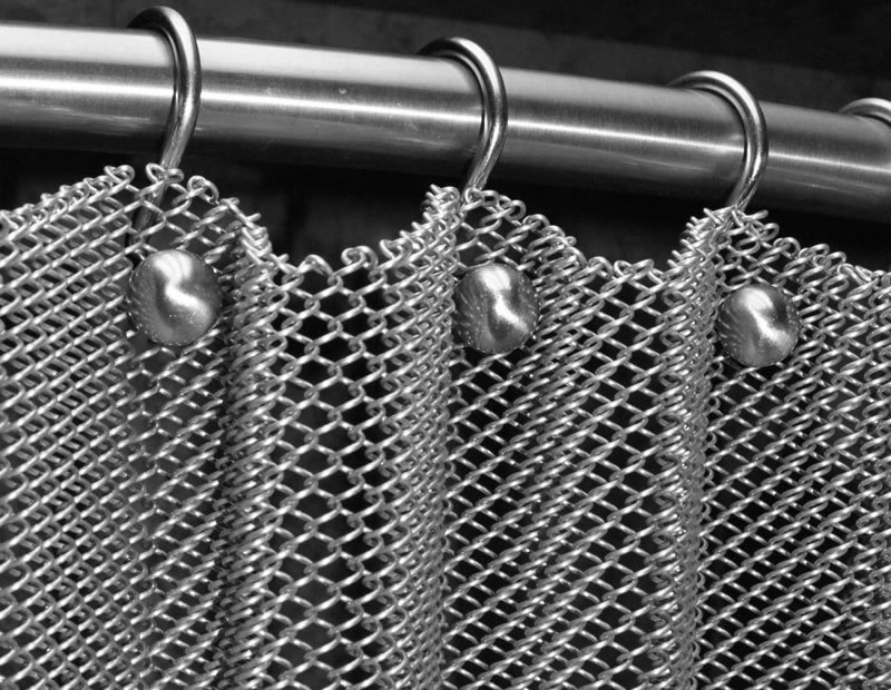 Flexible mesh curtain is installed on stainless steel curtain rod.