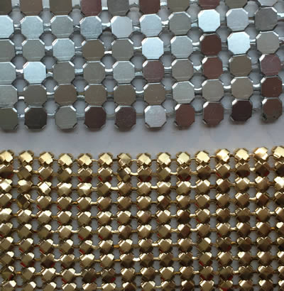 Two pieces of metal cloth curtain: one is octagonal shape in silver white and the other is flower shape in golden color.