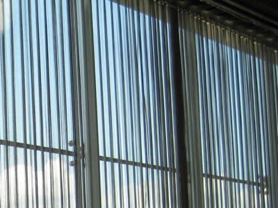 Silver flexible mesh curtain is installed as window curtain.