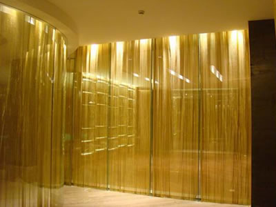 Brass metal cloth curtain is used at entertainment for decoration