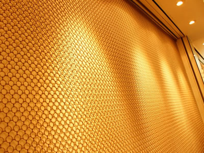 Brass circle ring mesh curtain is used to decorated the interior wall