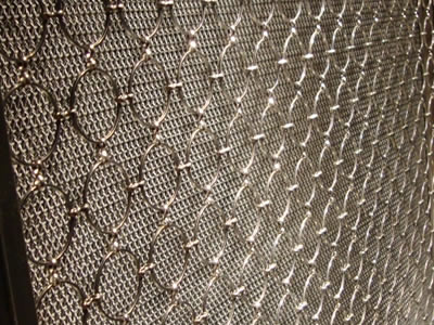 Stainless steel ring mesh curtain is used to decorated the door